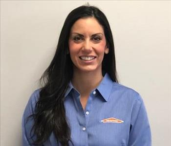 female employee with light blue SERVPRO shirt
