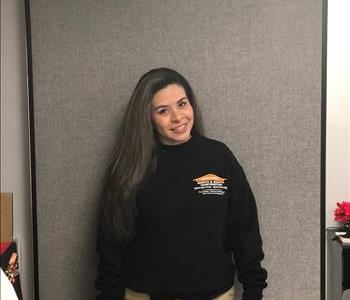 Female SERVPRO employee with black shirt