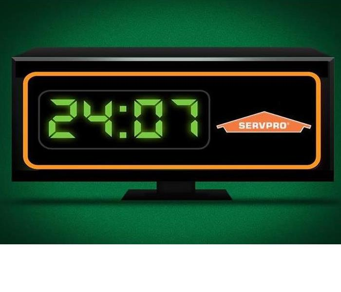 Digital alarm clock showing hours of 24/7